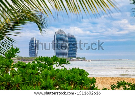 China Hainan Modern Architecture Hotels View Travel tropical coastline lanscape with sea, foliage and palm leaves