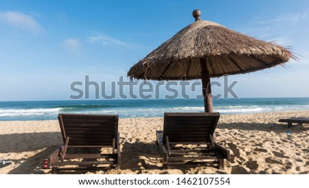 China Hainan Wanning Perfume Bay Beach is a straw shed and a recliner