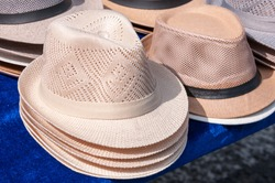 China, Heihe, July 2019: sale of men's hats at the market in Heihe in the summer