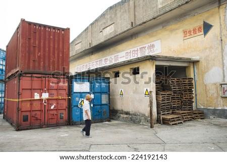 China, man walking through industrial area
