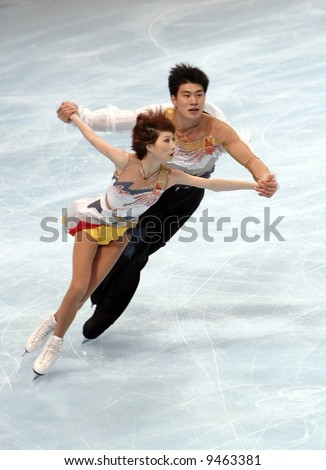 China's Dan and Hao Zhang perform during the pairs short program event during the Eric Bompard trophy. This is pair's short program for season 2007/2008 - stock photo