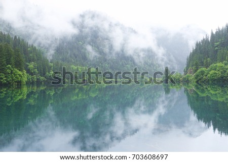 China 's Sichuan Province, Jiuzhaigou area of the corner of the water reflection. #703608697