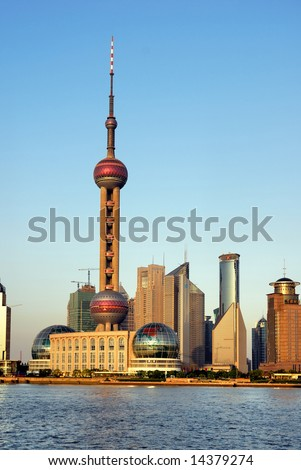 China Shanghai Pudong riverfront buildings at sunset and the pearl tower