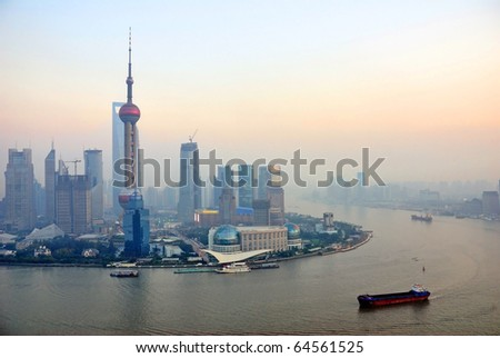 China Shanghai the pearl tower and Pudong skyline at sunset.