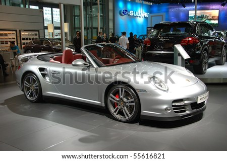 CHINA, SHENZHEN - JUNE 14: Shenzhen-Hong Kong-Macao Auto Show, newest Porsche presented on June 14, 2010 in Shenzhen. - stock photo
