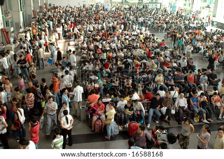 CHINA, SHUNDE TOWN, GUANGDONG PROVINCE - MARCH 10, 2006: crowd of Chinese people waiting at bus station.