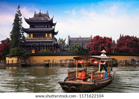 China traditional tourist boats at Shanghai Zhujiajiao town with boat and historic buildings, Shanghai China