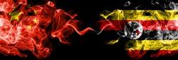 China vs Uganda, Ugandan smoke flags placed side by side. Thick colored silky smoke flags of Chinese and Uganda, Ugandan
