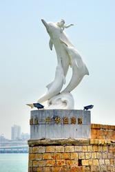 China Xiamen dolphins statue at the entry of Gulang-yu harbor