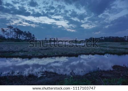 Chincoteague Island, Virginia, USA: Sunrise at Black Duck Pool, in the Chincoteague National Wildlife Refuge.
