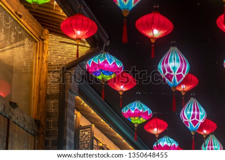 Chinese Ancient Architecture with Red Lanterns and Colorful Lanterns