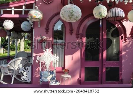Chinese and Japanese lanterns hanging on a pink porch in Wesleyan Grove on Martha's Vineyard, MA. Taken at Marsh's Vineyard Camp Meeting Association.  Photo stock ©