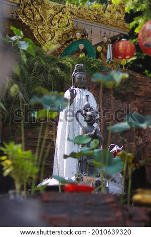 Chinese Bodhisattva or Goddess of Compassion, Mercy and Kindness statue, also known as, Guan Yim or Dewi Kwan Im at Thailand Buddhism Shrine Nam Hai Kwan Se Im Pu Sa Vihara Sukabumi, Indonesia. Stok fotoğraf ©