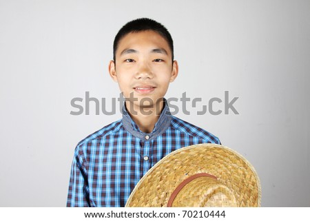Chinese boy / A smile boy wearing farmer hat