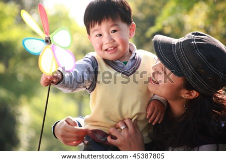 chinese boy and his mother at garden