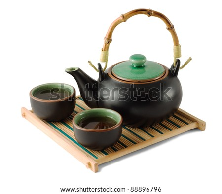 Chinese brown teapot and teacups on the wooden trivet isolated on white - stock photo