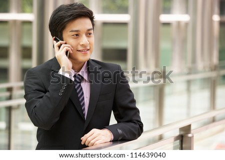 Chinese Businessman Outside Office On Mobile Phone