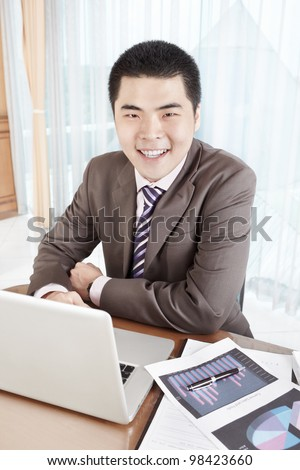 Chinese businessman working in office