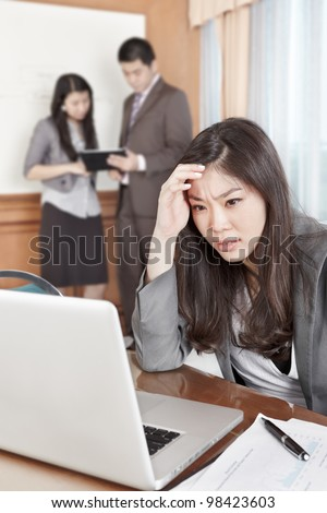 Chinese businesswoman looks depressed working in the office