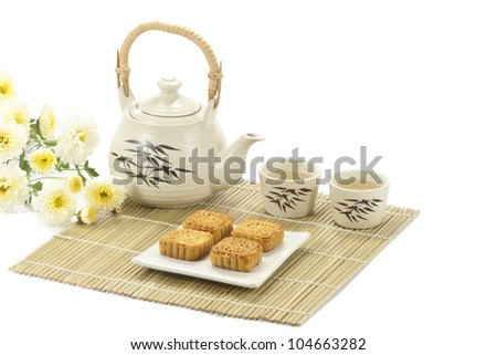 Chinese cake with Tea on bamboo mat