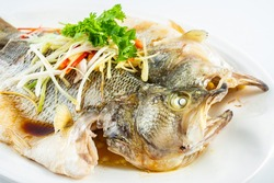 Chinese Cantonese cuisine dish with steamed squid on white background