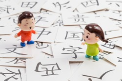 Chinese character CARDS and cartoon dolls(Translation:Dad, field, winter, four, home, thousand, China, it, expensive, spring, gan, in, the country, save, pig, wen, I, live, east, west, wide, clothes)