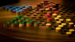 Chinese checkers board during game play all colours