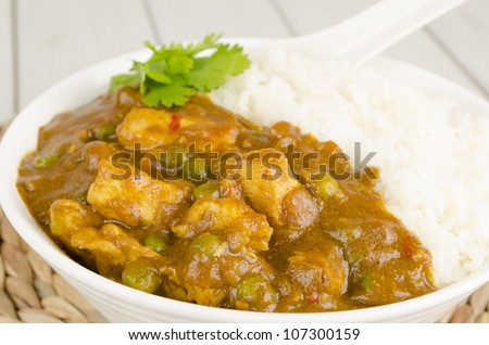 Chinese Chicken Curry served with rice. Close up.