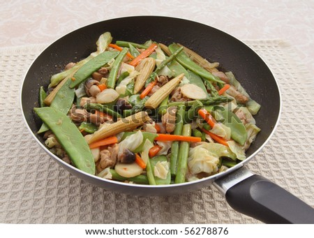 chinese chicken vegetable stir-fry in skillet