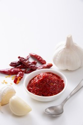 Chinese Chili Bean Sauce, sweet soy sauce and Korean red chili paste on a white background