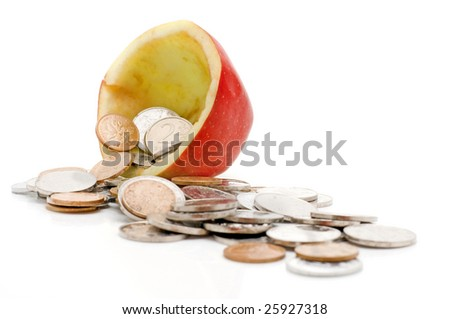 Chinese coins in red apple, isolated on white