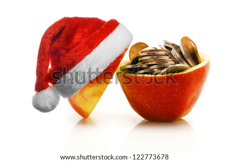 Chinese coins in red apple with santa hat, isolated on white
