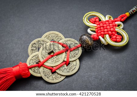 chinese coins of luck on black background. #421270528