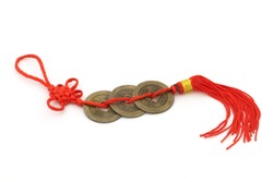 Chinese coins of luck with red string isolated on white background. Feng shui symbol