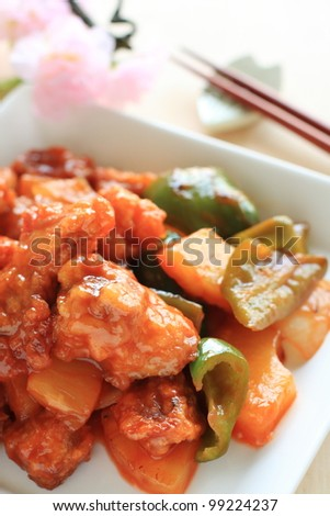 Chinese cuisine, sour and sweet spare rib with pineapple and green pepper - stock photo