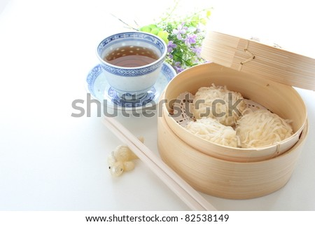 Chinese cuisine, steamed dim sum on traditional bamboo steamer
