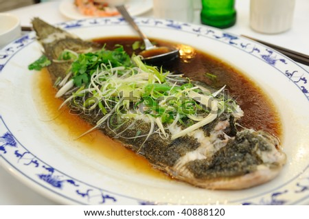 Chinese cuisine - steamed fish with soy sauce - stock photo