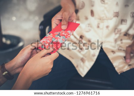 Chinese Culture in Chinese New Year , People will Giving Red Envelope (Ang Pao) in This Festival  to Bestow Happiness and Blessings on the Receivers