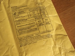 Chinese customs declaration and postage meter on a foreign parcel from china. (Translation: see English text below each Chinese text)