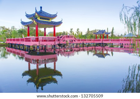 chinese decoration building on the lake - stock photo