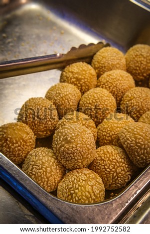 Chinese dessert sesame donuts in self serve buffet tray