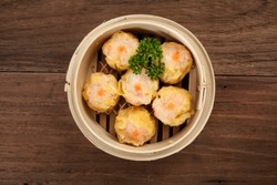Chinese dim sum in a bamboo steamer box