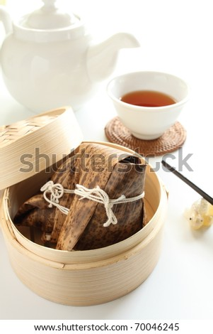 Chinese Dim sum, sticky rice wrapped in bamboo leaf