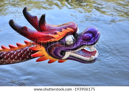 Chinese dragon head as a prow of a boat