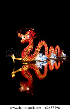 Chinese Dragon Lantern in pond.