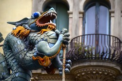 Chinese dragon on 19th century House of Umbrellas (Casa Bruno Cuadros) building on La Rambla in Barcelona, Catalonia, Spain.