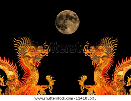 Chinese dragon statue and the moon.