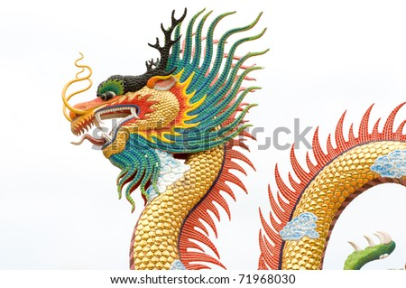 Chinese dragon statue on white background - stock photo