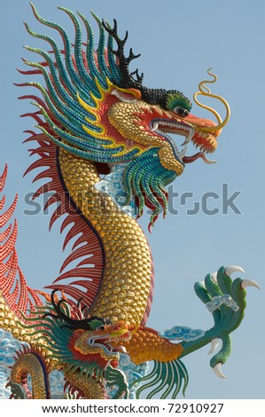 Chinese dragon statue with blue sky - stock photo