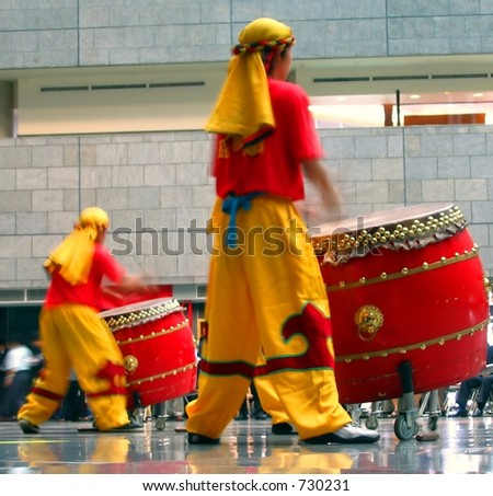 Chinese Drummers at Work  -- this type of drum is called Tagu in Chinese and Taiko in Japanese